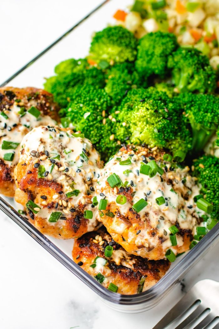 A lunch box version of the meatball sausage patties with broccoli and cauli rice