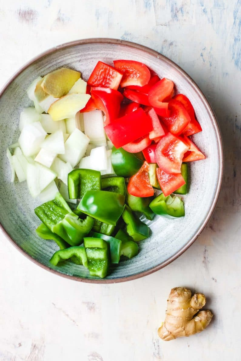 Vegetables diced to cubes and ready in a plate.