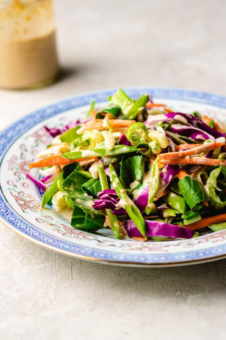 Paleo Asian Coleslaw recipe, tossed in a creamy Whole30 sesame dressing.