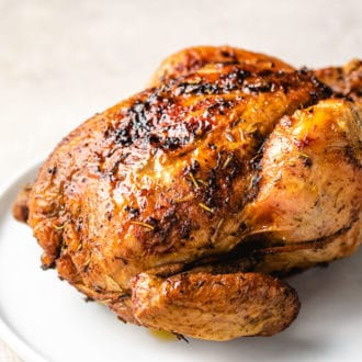 Air Fryer Whole Chicken recipe with garlic-herb dry spice rub from I Heart Umami.