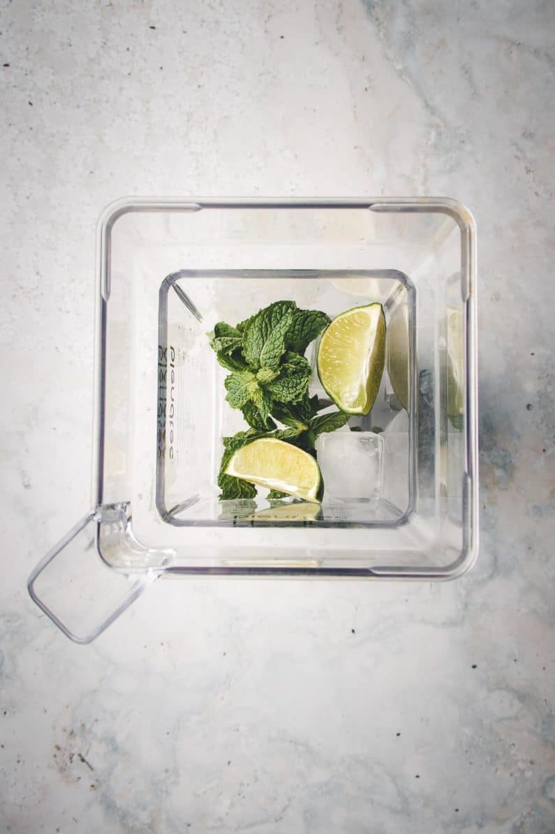 Mint, lime, and crushed ice for fruit salad