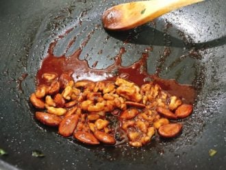 Add walnuts and almonds to the sauce