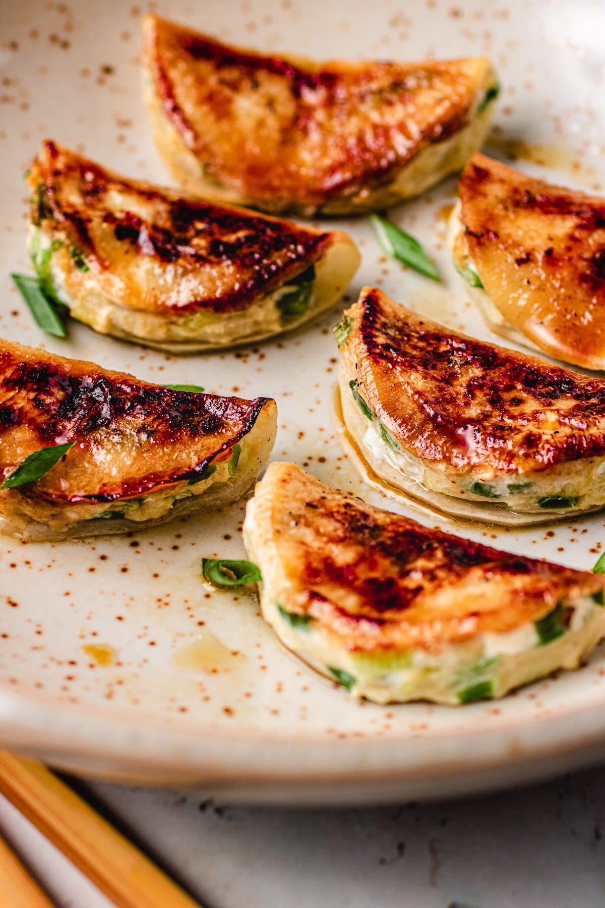 Pan fried potsticker dumplings on a plate I Heart Umami