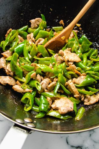 Photo shows stir fry the ingredients in a wok