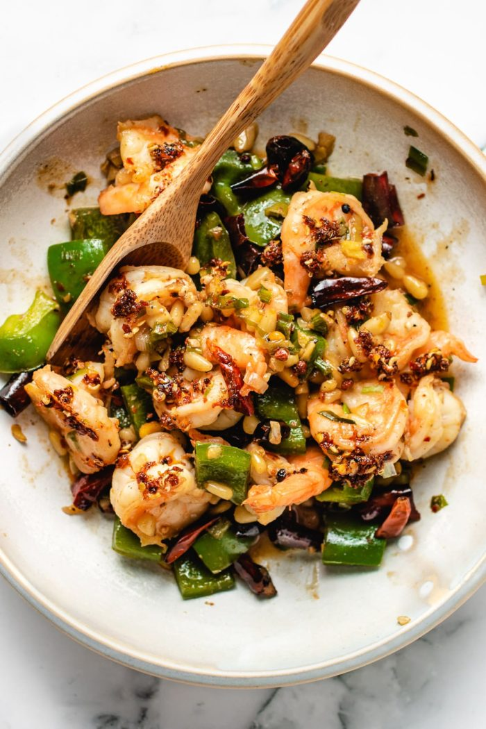 A feather photo shows the shrimp kung pao dish
