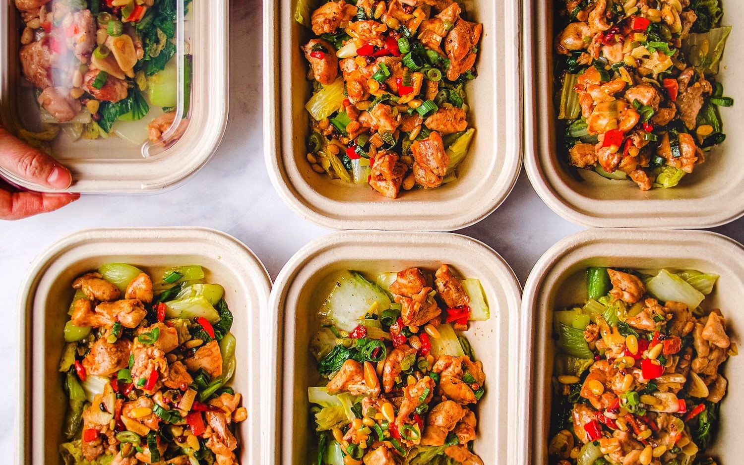 Paleo Kung Pao Chicken in meal prep boxes