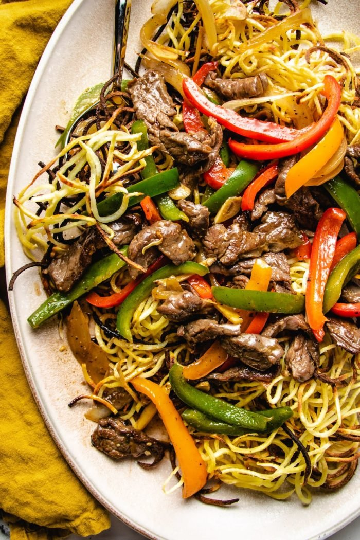A close shot shows the chow mein and beef in an oval plate
