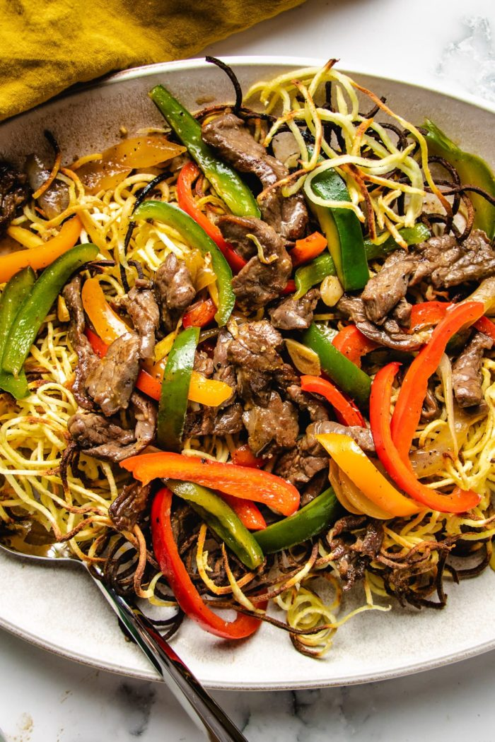 Saucy beef stir-fry on top of crispy chow mein noodles