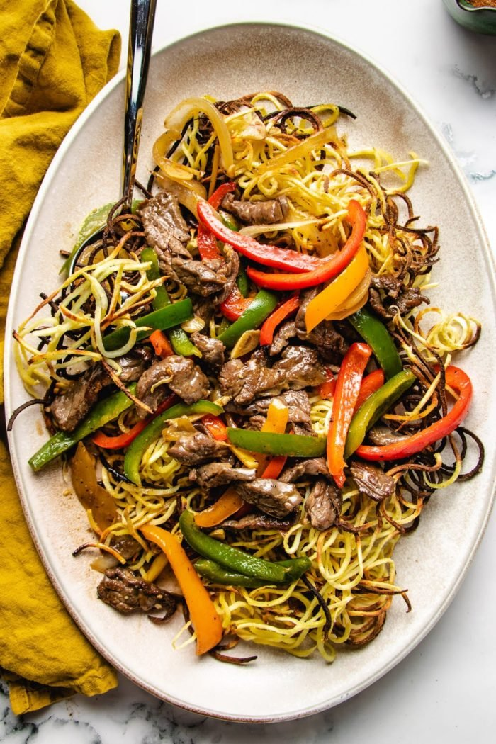 Cantonese beef chow mein crispy noodles feature images served on a large oval plate