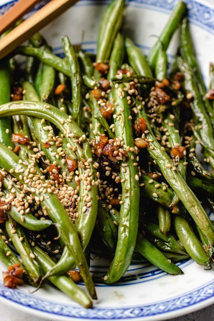 Perfectly blistered green beans recipe Chinese style served in a blue plate