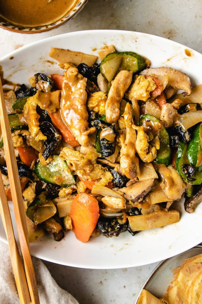 Serve the chicken moo shu with hoisin sauce and pancakes