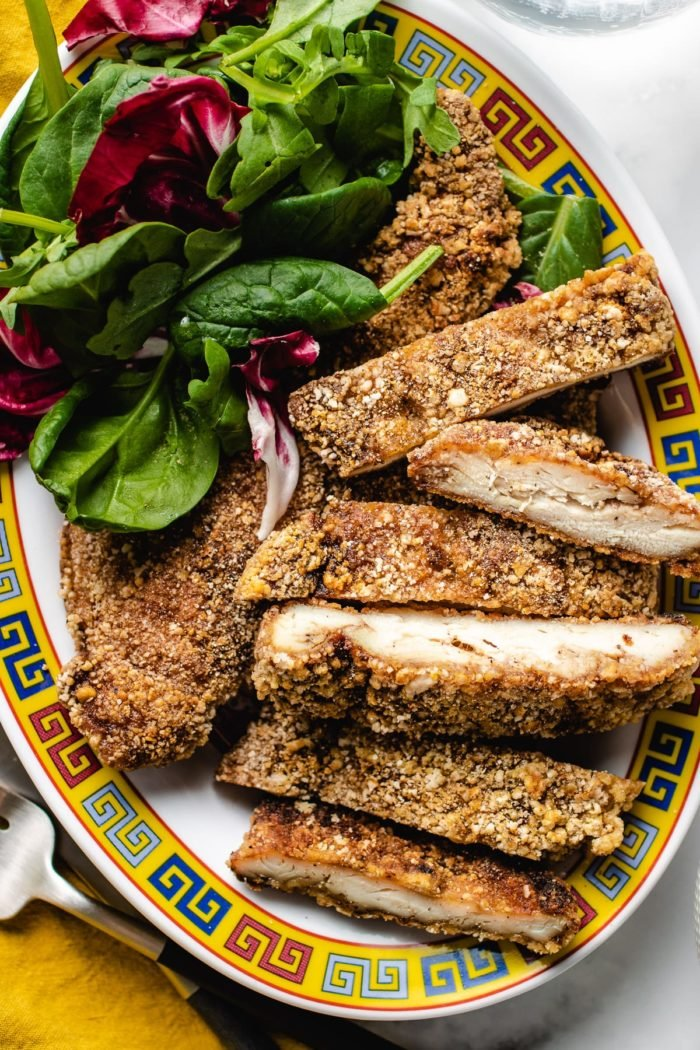 A plate of crunchy Taiwanese fried chicken cut up with salads