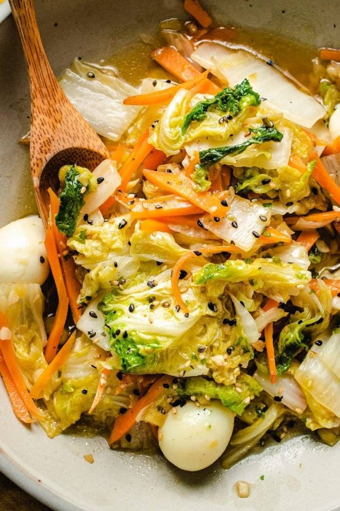 A close shot photo of the stir-fried napa cabbage with quail eggs