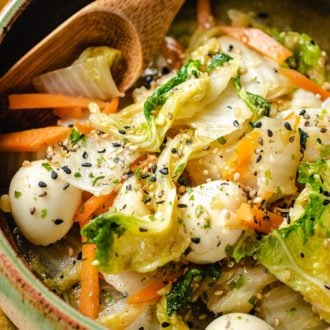 Sauteed Napa Cabbage served in a green bowl