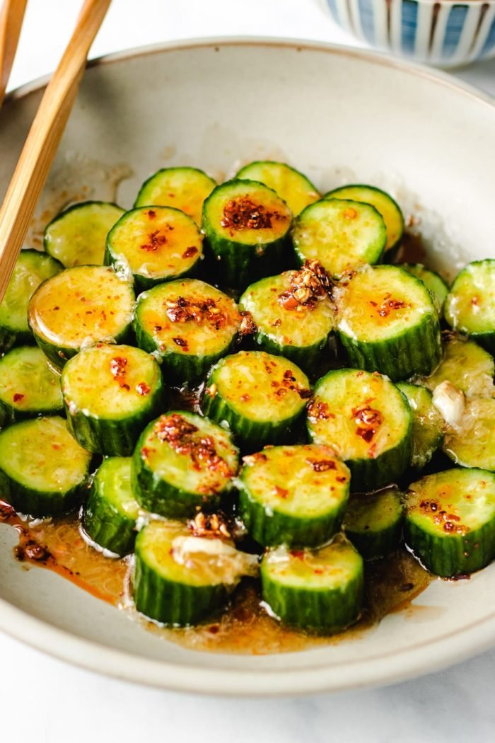 A side shot photo shows the cucumbers with dressing