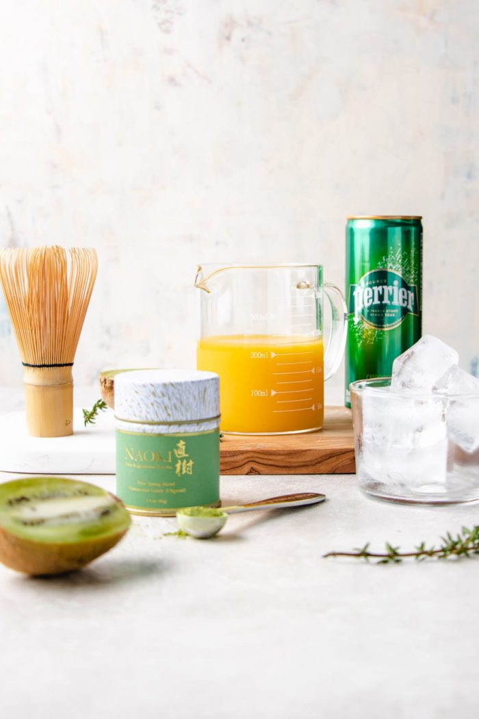 Ingredients to make the matcha ice tea on a white board