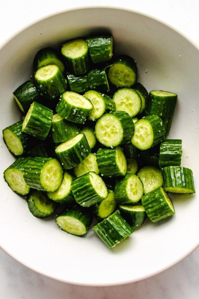Sprinkle salt all over the cucumbers