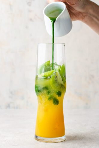 Pour the matcha tea into the glass on top of the mango juice