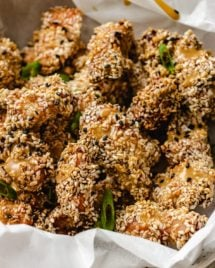 A plate loaded with crispy sesame chicken