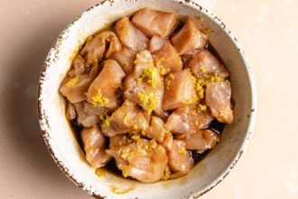 Marinated diced chicken in a white bowl