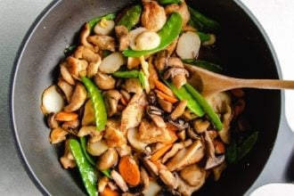 Photo shows adding all the ingredients to the pan and stir-fried together