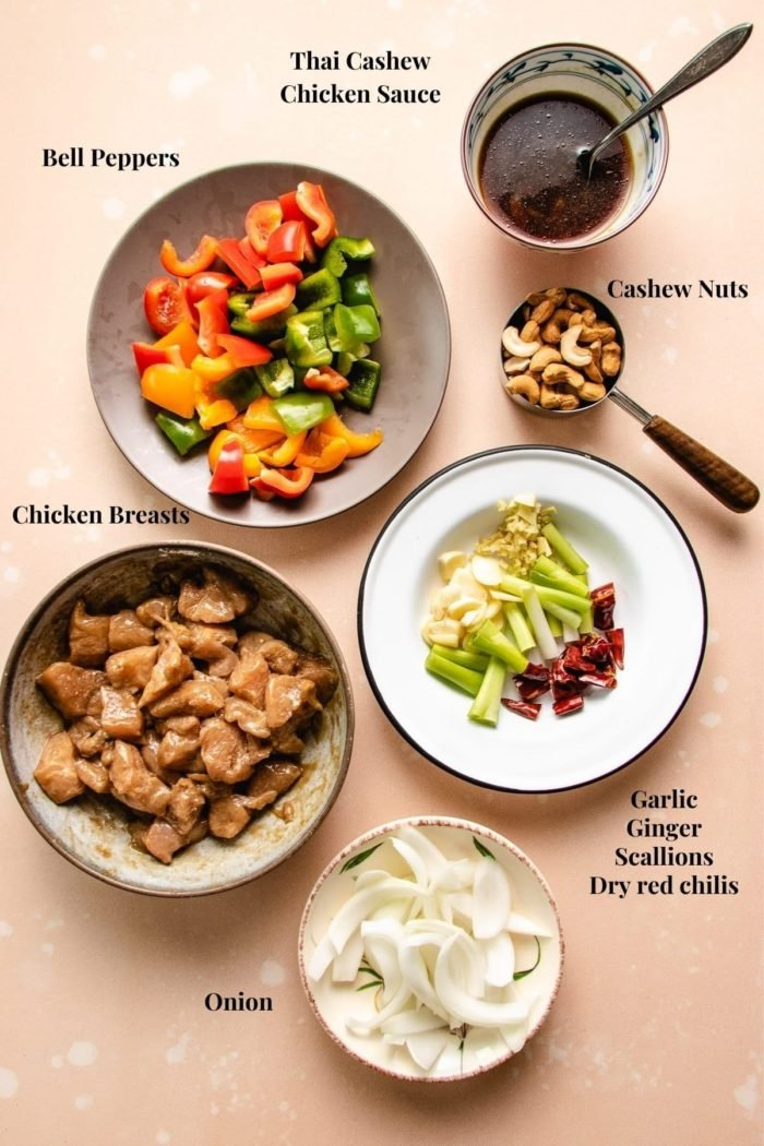 Ingredients to make Thai style cashew chicken stir fry prepared in bowls and plates